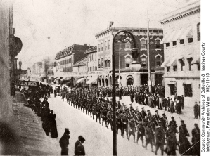 The 39th Battalion marches south down Front Street from Bridge Street East in 1915.
