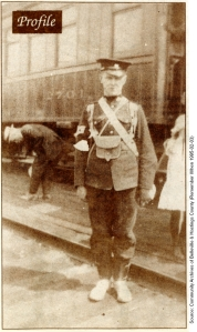 Archie Cooke stands at the train station in Belleville ca. August 1914.