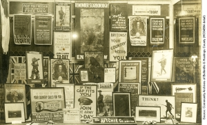 Recruiting posters, paintings and photographs are shown in window display at Ritchie's, Belleville, March, 1915  (HC04894 detail)